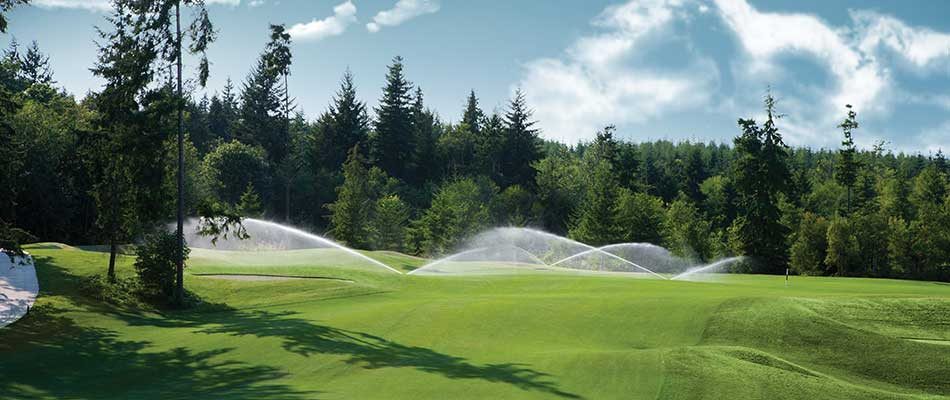 Sprinkler system watering a golf course in Clarklake, MI.
